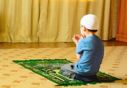 Little Muslim worshiper.