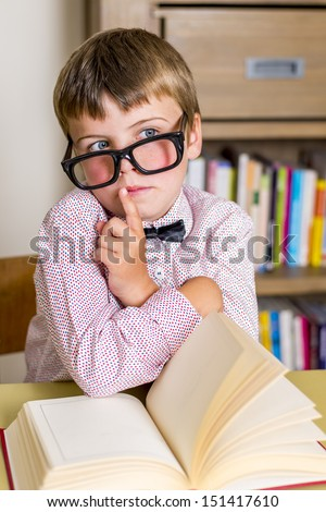 little nerdy boy with geeky goggles,doing silent gesture