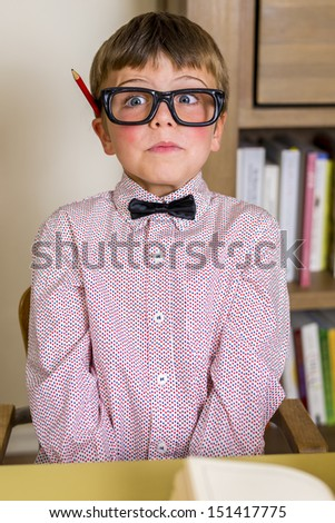 little nerdy boy with geeky goggles, making facial expressions.