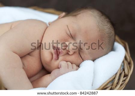 Little newborn girl is sleeping.