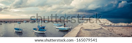 Little old boats in the harbor of Mola di Bari, south of Italy