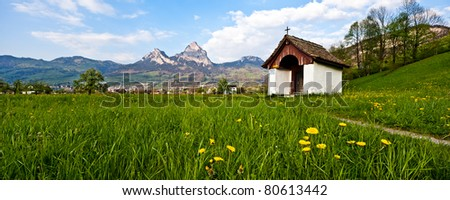 Little old chapel in a blooming green field