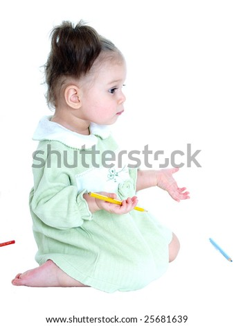 Little one year old girl with pencils isolated on white