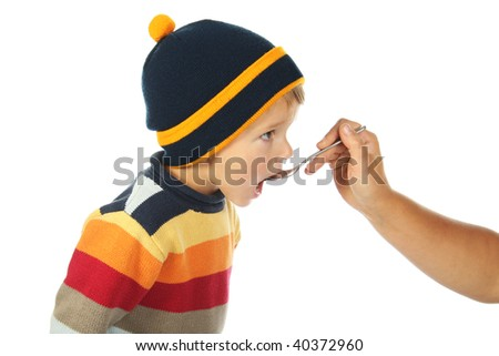 little open-mouthed boy in the sweater with spoon held by the adult person's hand