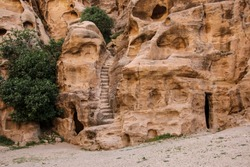 Little Petra in Siq al-Barid, Wadi Musa, Jordan. The architectural ensemble Little Petra is the temples cut in the rocks, altars, stairs, rooms, ritual rooms
