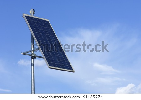 little photovoltaic panel with cloudy sky