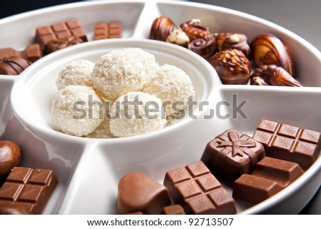 Little pieces of chocolate on white plate