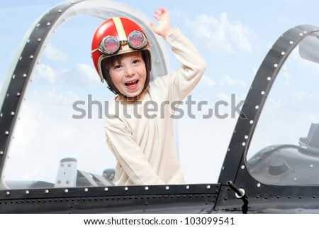 Little pilot in cockpit of a vintage plane. Close up with shallow DOF.