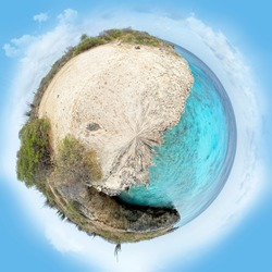 Little planet panorama on white sandy beach in paradise sea near Washington Slagbaai National Park in Bonaire