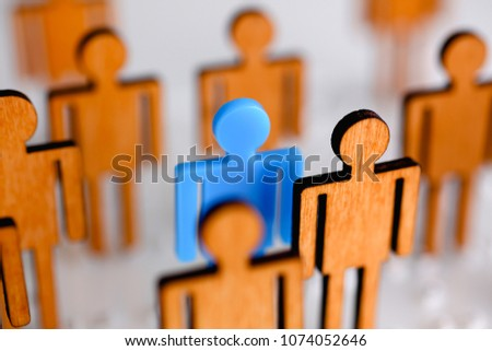 Little plastic blue toy figure stand out from unit crowd line closeup. One worker against odd hr job shift head hunter rare disease unit dismissal retire lgbt media virus epidemic success concept
