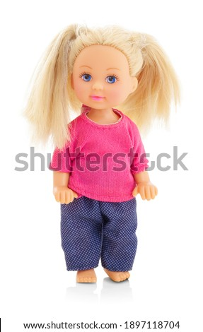 little plastic doll, baby girl. Little blonde doll with blue eyes on white bg. Isolated on white background with shadow reflection. With red shirt and checkered pants. Stock photo ©