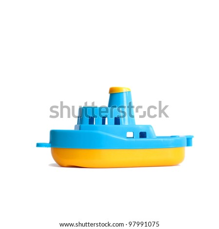 little plastic toy ship isolated on white