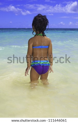little Polynesian girl at the beach in the ocean