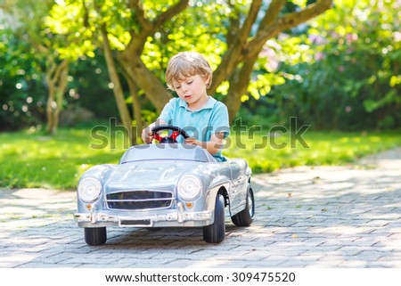 little preschool boy driving...