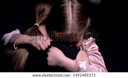 Little pretty daughter hugging her mother, bad dream, children phobias and fears #1492489373