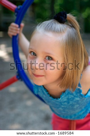 Little pretty girl at the playground