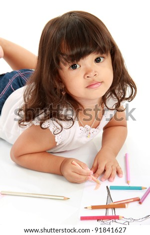 little pretty girl drawing and coloring with pencil color on a white background