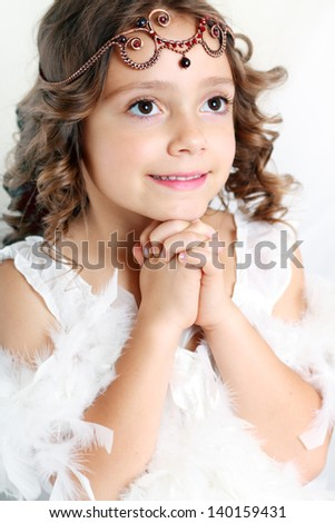 little princess angel beautiful cute girl wearing diadem praying - stock-photo-little-princess-angel-beautiful-cute-girl-wearing-diadem-praying-140159431