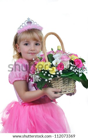 Little  princess in pink  with  basket of flowers