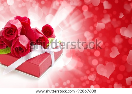 Little red gift with roses on festive background