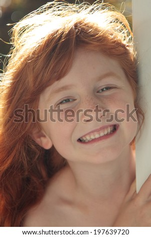 little red haired girl with back lighting