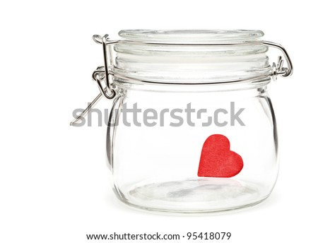 Little red heart in preserving glass over white background