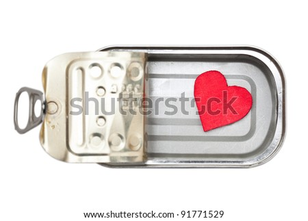 Little red heart in tin can isolated on white