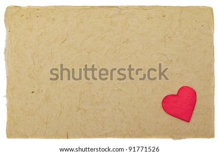 Little red heart on vintage paper with copyspace