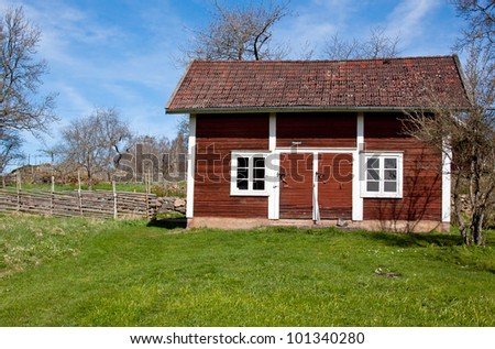 Little red house in Sweden. - stock photo