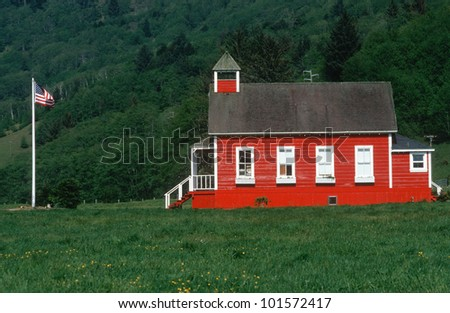 Little Red Schoolhouse with American flag, Coastline, Oregon