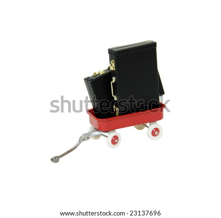 Little red wagon brings back memories of childhood holding leather briefcases used to carry items to the office