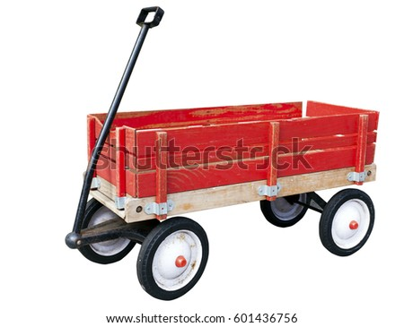 Little red wood wagon. Weathered. Faded. Isolated on white.
