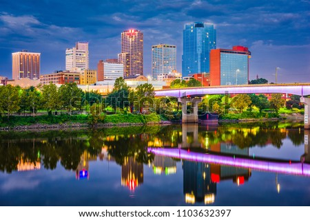 Little Rock, Arkansas, USA skyline on the river at twilight. #1103632397