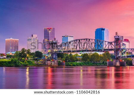 Little Rock, Arkansas, USA skyline on the river at twilight. #1106042816