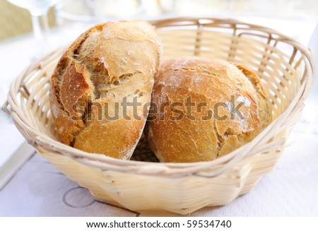 little roll breads in basket on table - stock photo