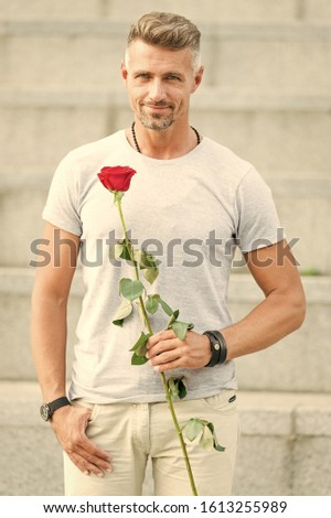 Little romance can enhance your love life. Handsome guy with rose flower romantic date. Valentines day and anniversary. Flowers delivery. Romantic gentleman. Man mature macho with romantic gift.
