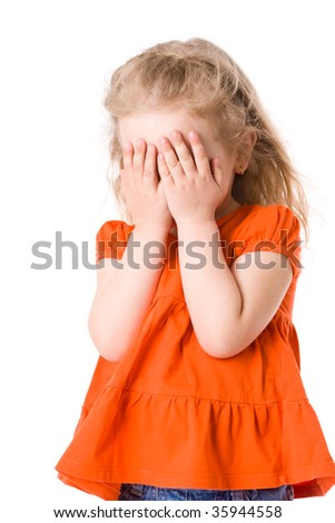 Little scared girl hiding face isolated on white