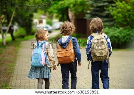 Little school students hurry on occupations.