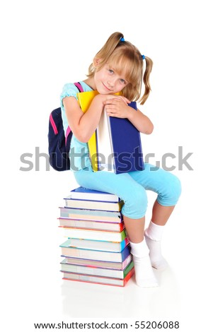 Little schoolgirl sitting on a pile of books