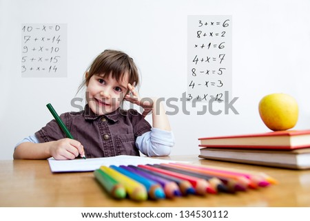 Little schoolgirl writing