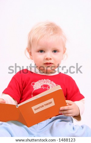 Little scientist - little boy reading very difficult book