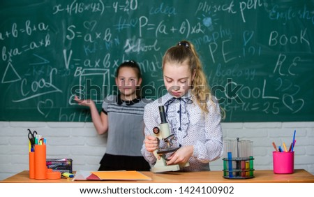 Little scientist work with microscope. Little girls in school lab. Microscope. Testing your blood. Children using microscope. Biology lesson. Back to school. science experiments in laboratory. #1424100902