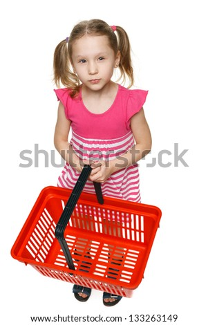 Little shopper. Little girl in full length holding empty shopping basket and thinking what gifts to buy, over white background