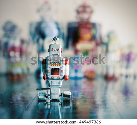 little silver robot toy on...