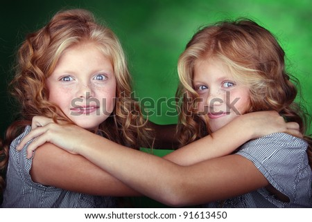 Little sisters hold each other