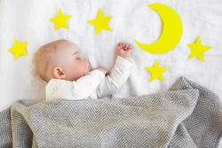 Little sleepy child in the bed. Cute baby sleeping