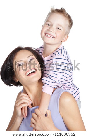 Little smiling boy and his mother hugging each other over white