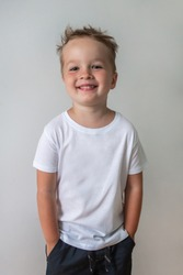 little smiling  boy in white shirt isolated on white background