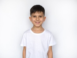 little smiling boy in white t-shirt isolated on white