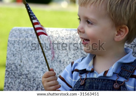 Little smiling boy with American flag, Fourth of July